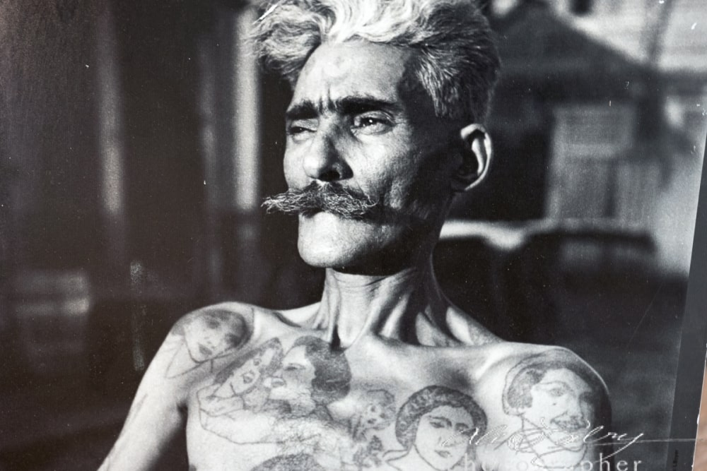 Old B&W photo of a prisioner