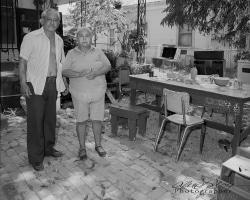 Husband and wife in front yard, San Antonio, Texas